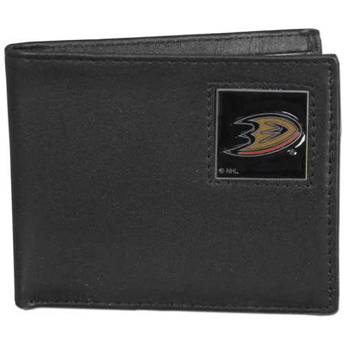 Anaheim Ducks Leather Bi-fold Wallet - Officially licensed NHL Anaheim Ducks fine grain leather bi-fold wallet features numerous card slots, large billfold pocket and flip up window ID slot. This quality Anaheim Ducks wallet has an enameled Anaheim Ducks emblem on the front of the wallet. Thank you for visiting CrazedOutSports