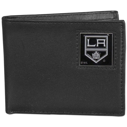 Los Angeles Kings Leather Bi-fold Wallet - Officially licensed NHL Los Angeles Kings fine grain leather bi-fold wallet features numerous card slots, large billfold pocket and flip up window ID slot. This quality Los Angeles Kings wallet has an enameled Los Angeles Kings emblem on the front of the wallet.