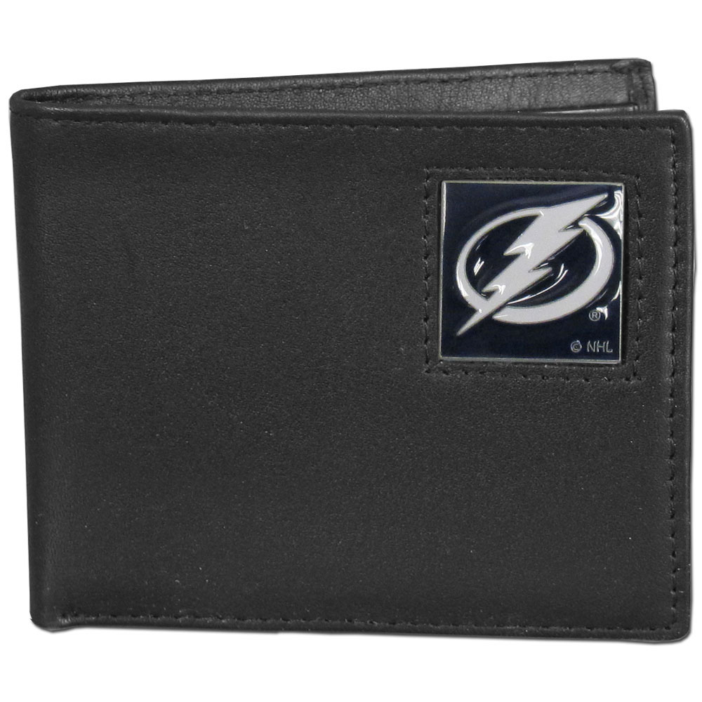 Tampa Bay Lightning® Leather Bi-fold Wallet - Our officially licensed fine grain leather bi-fold wallet features numerous card slots, large billfold pocket and flip up window ID slot. This quality wallet has an enameled Tampa Bay Lightning® emblem on the front of the wallet.