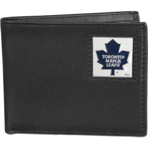 NHL Bifold Wallet in Box -  Toronto Maple Leafs - Our  NHL Bi-fold wallet is made of high quality fine grain leather and includes credit card slots and photo sleeves. Team logo is sculpted and enameled with fine detail on the front panel. Packaged in a window box that can be placed on a shelf or hung by a peg.