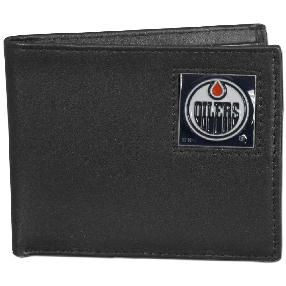 Edmonton Oilers® Leather Bi-fold Wallet - Our officially licensed fine grain leather bi-fold wallet features numerous card slots, large billfold pocket and flip up window ID slot. This quality wallet has an enameled Edmonton Oilers® emblem on the front of the wallet.
