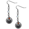 Edmonton Oilers Crystal Dangle Earrings - These NHL Edmonton Oilers Crystal Dangle Earrings are the perfect accessory for your game day outfit! The Edmonton Oilers Crystal Dangle Earrings are approximately 1.5 inches long and feature an iridescent crystal bead and nickel free chrome Edmonton Oilers charm on nickel free, hypoallergenic fishhook posts.