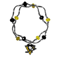 Pittsburgh Penguins Crystal Bead Bracelet - Officially licensed Pittsburgh Penguins crystal bead bracelet with Pittsburgh Penguins colored crystal separated with chrome helix beads. The Pittsburgh Penguins Crystal Bead Bracelet features a Pittsburgh Penguins charm with exceptional detail.