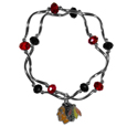 Chicago Blackhawks Crystal Bead Bracelet - Officially licensed Chicago Blackhawks crystal bead bracelet with Chicago Blackhawks colored crystal separated with chrome helix beads. The Chicago Blackhawks Crystal Bead Bracelet features a Chicago Blackhawks charm with exceptional detail.