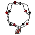 New Jersey Devils Crystal Bead Bracelet - Officially licensed New Jersey Devils crystal bead bracelet with New Jersey Devils colored crystal separated with chrome helix beads. The New Jersey Devils Crystal Bead Bracelet features a New Jersey Devils charm with exceptional detail.