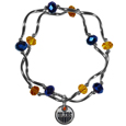 Edmonton Oilers Crystal Bead Bracelet - Officially licensed Edmonton Oilers crystal bead bracelet with Edmonton Oilers colored crystal separated with chrome helix beads. The Edmonton Oilers Crystal Bead Bracelet features a Edmonton Oilers charm with exceptional detail.