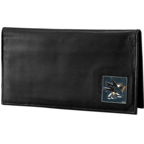 NHL Dlx. Checkbook Cover in Box - San Jose Sharks - San Jose Sharks deluxe NHL checkbook cover is made of high quality leather and includes a card holder, clear ID window, and inside zipper pocket for added storage. San Jose Sharks logo square is sculpted and enameled with fine detail. Packaged in a window box.