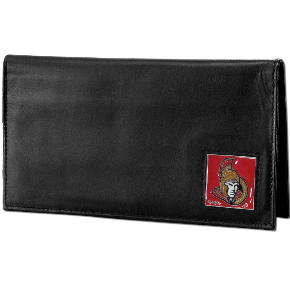 Ottawa Senators® Deluxe Leather Checkbook Cover - Our officially licensed checkbook cover is made of high quality leather and includes a card holder, clear ID window, and inside zipper pocket for added storage. Fully cast and enameled Ottawa Senators® team emblem on the front of the wallet.