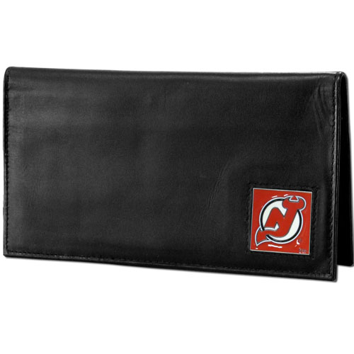 NHL Dlx. Checkbook Cover in Box - New Jersey Devils - New Jersey Devils deluxe NHL checkbook cover is made of high quality leather and includes a card holder, clear ID window, and inside zipper pocket for added storage. New Jersey Devils logo square is sculpted and enameled with fine detail. Packaged in a window box.