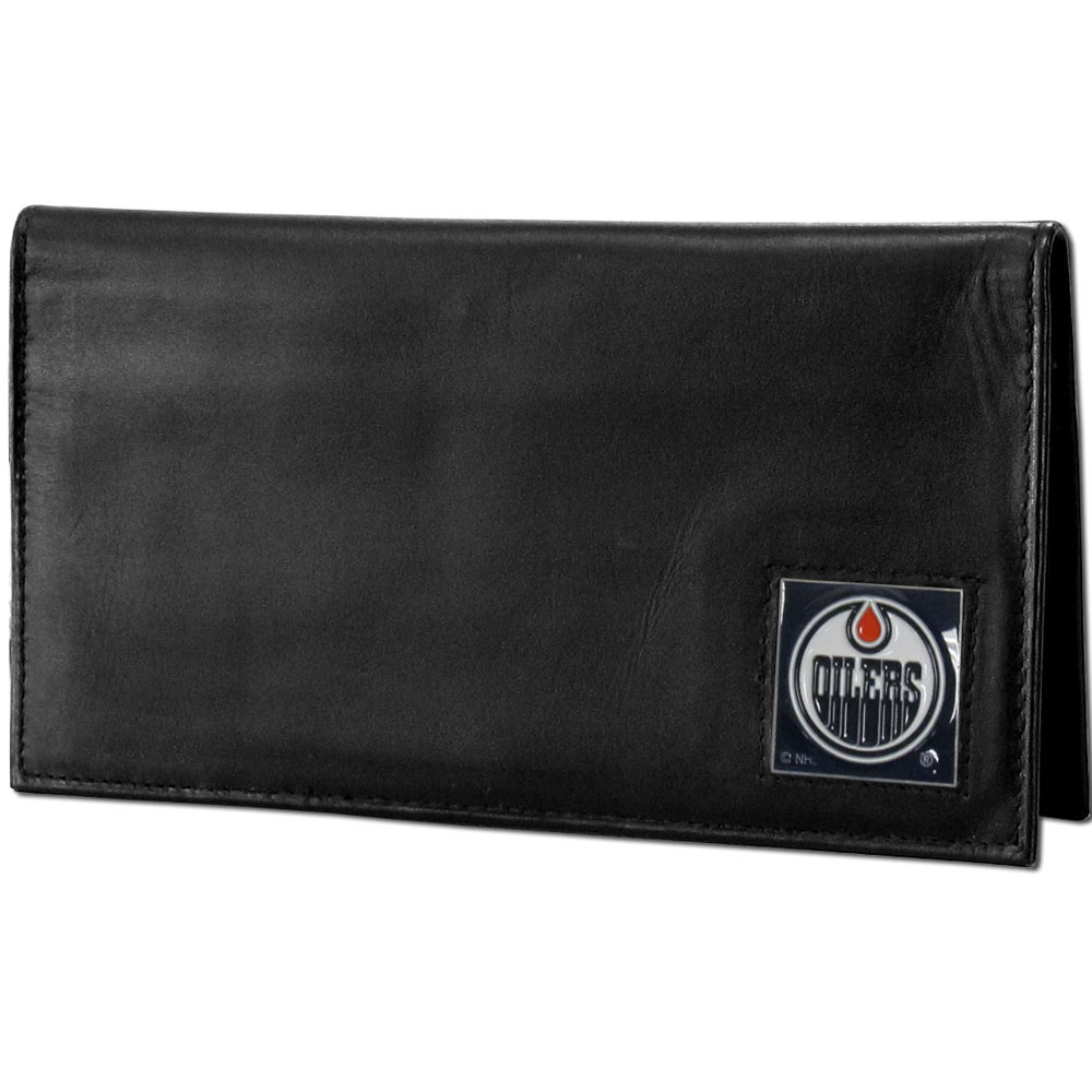 Edmonton Oilers® Deluxe Leather Checkbook Cover - Our officially licensed checkbook cover is made of high quality leather and includes a card holder, clear ID window, and inside zipper pocket for added storage. Fully cast and enameled Edmonton Oilers® team emblem on the front of the wallet.