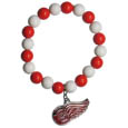 Detroit Red Wings Fan Bead Bracelet - These bright Detroit Red Wings Fan Bead Bracelet stretch to fit and feature a full metal Detroit Red Wings charm with enameled Detroit Red Wings details. Perfect, eye catching game day accessory. Thank you for visiting CrazedOutSports
