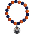 Edmonton Oilers  Fan Bead Bracelet - Flash your Edmonton Oilers spirit with this bright stretch Edmonton Oilers Fan Bead Bracelet. This new Edmonton Oilers Fan Bead Bracelet features multicolored Edmonton Oilers beads on stretch cord with a nickel-free enameled chrome Edmonton Oilers charm. This Edmonton Oilers Fan Bead Bracelet adds the perfect pop of color to your game day accessories.