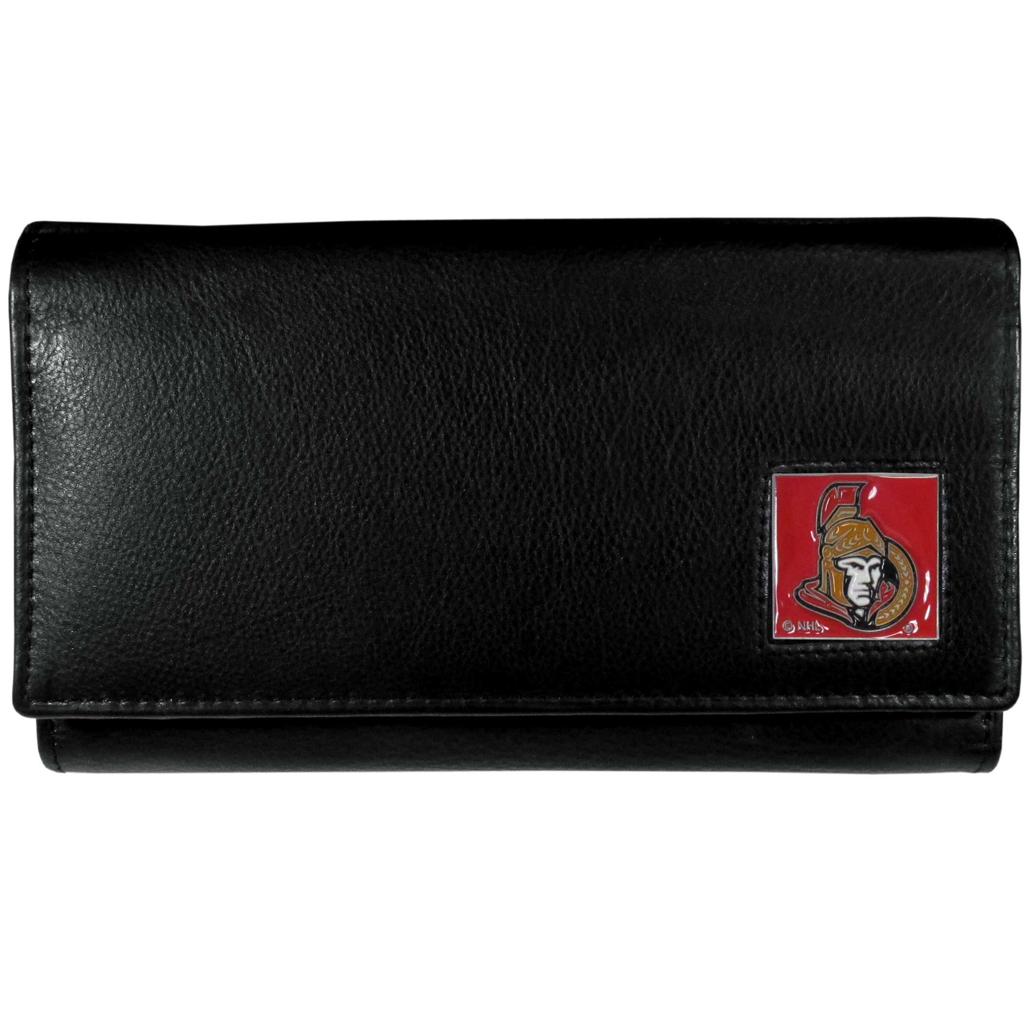 Ottawa Senators® Leather Women's Wallet - This genuine leather women's pocketbook features 9 credit card slots, a windowed ID slot, spacious front pocket, inner pocket and zippered coin pocket. The front of the pocketbook has a hand painted metal square with the Ottawa Senators® primary logo.