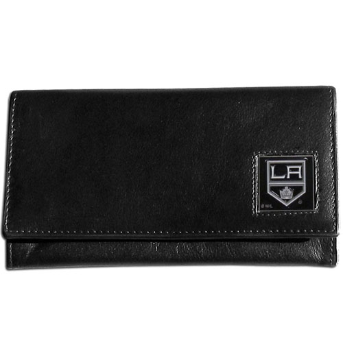 Los Angeles Kings Leather Women's Wallet - Officially licensed NHL Los Angeles Kings genuine leather women's pocketbook features 9 credit card slots, a windowed ID slot, spacious front pocket, inner pocket and zippered coin pocket. The front of the Los Angeles Kings pocketbook has a hand painted metal square with the Los Angeles Kings emblem on the front.