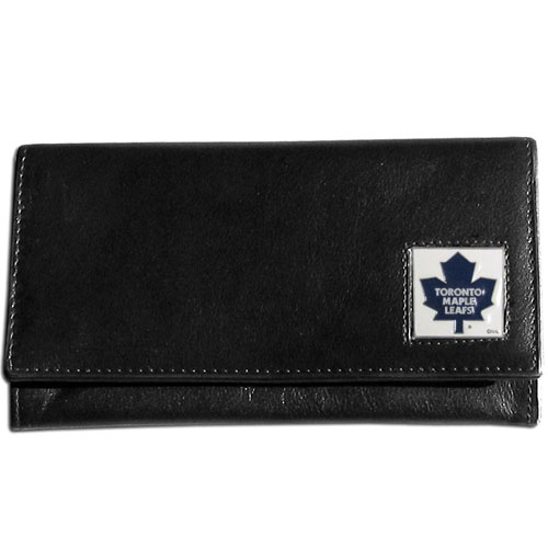 NHL Female Wallet - Toronto Maple Leafs - This Toronto Maple Leafs genuine leather women's pocketbook features 9 credit card slots, a windowed ID slot, spacious front pocket, inner pocket and zippered coin pocket. The front of the Toronto Maple Leafs pocketbook has a hand painted metal square with the Toronto Maple Leafs primary logo.