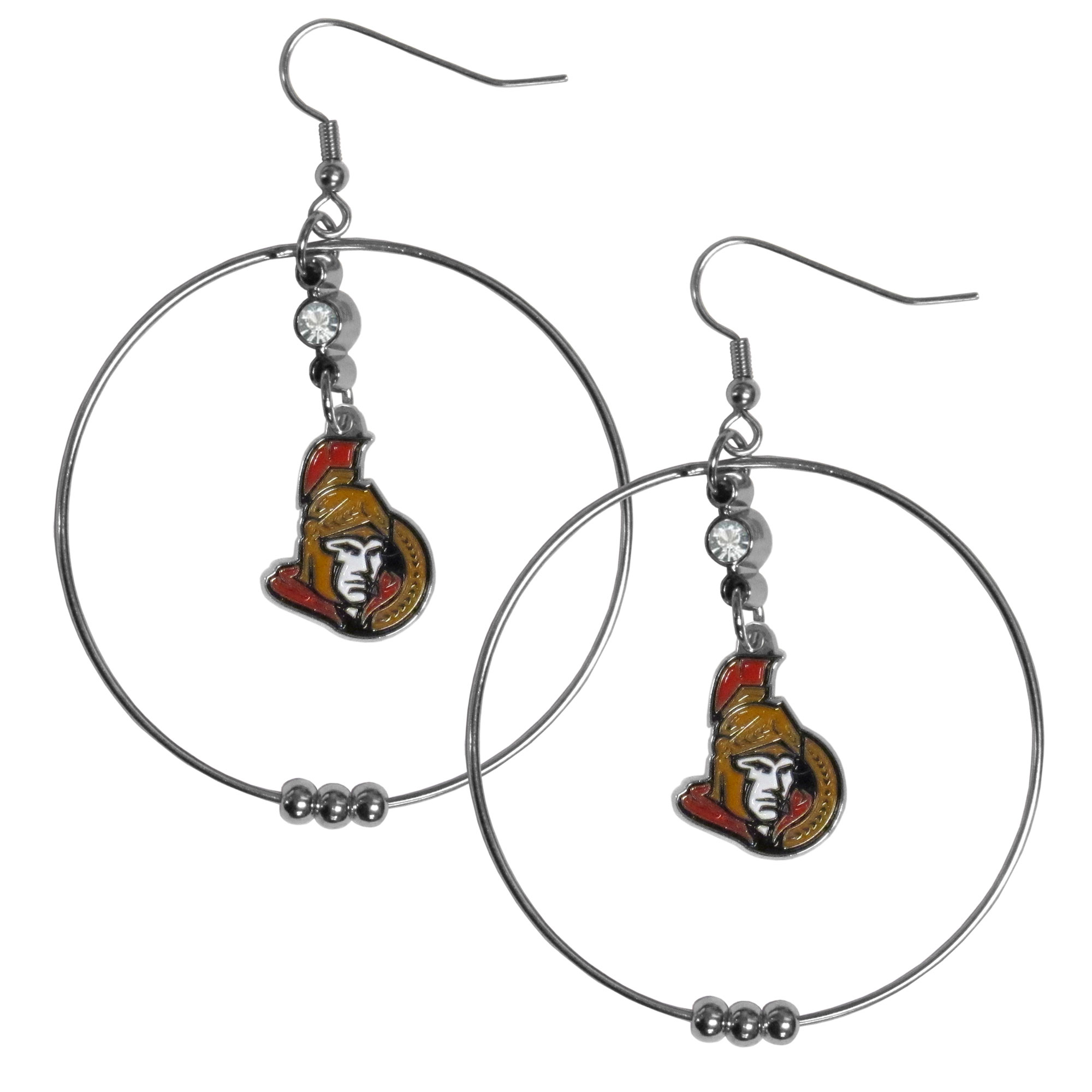 Ottawa Senators® 2 Inch Hoop Earrings - Our large hoop earrings have a fully cast and enameled Ottawa Senators® charm with enameled detail and a high polish nickel free chrome finish and rhinestone access. Hypoallergenic fishhook posts.