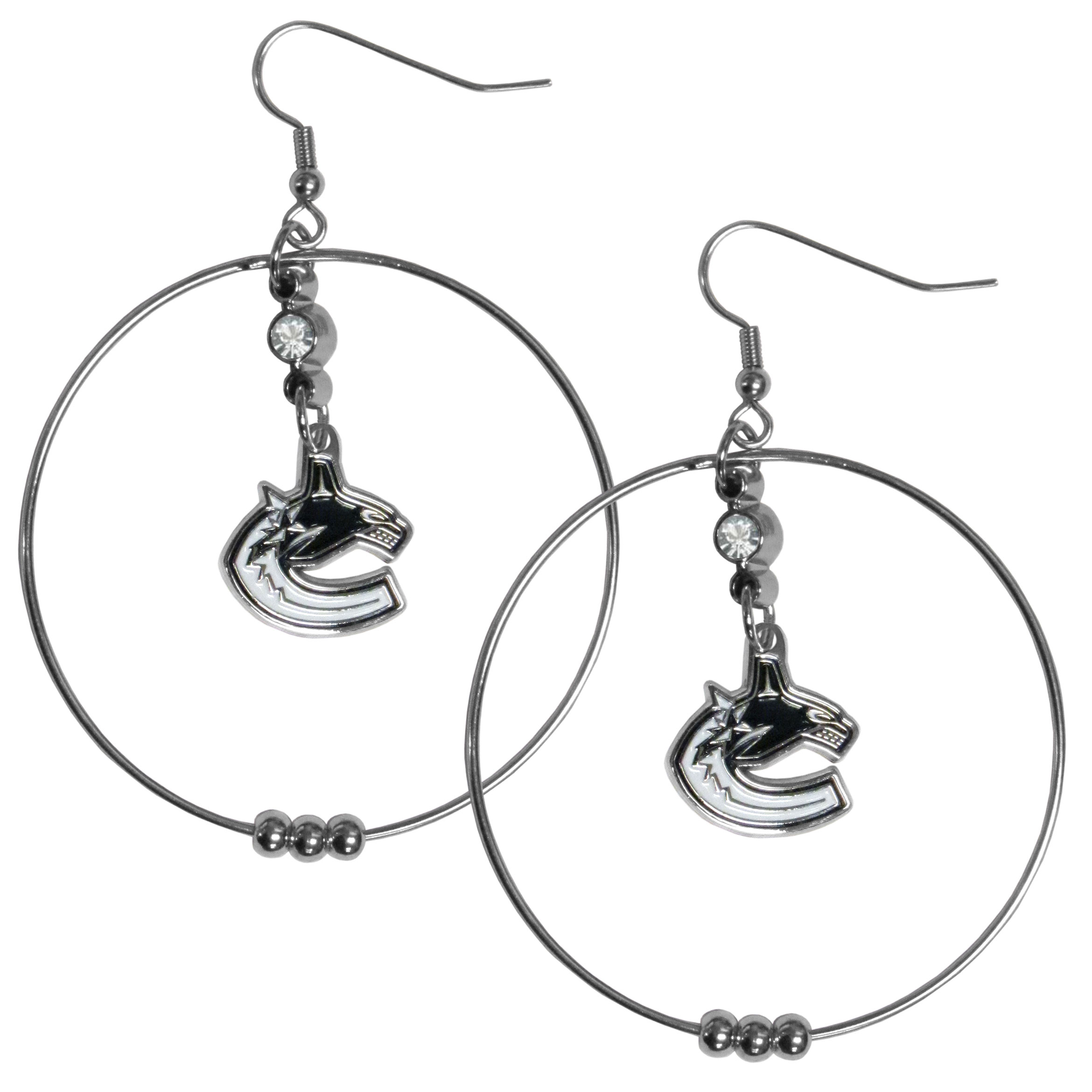 Vancouver Canucks® 2 Inch Hoop Earrings - Our large hoop earrings have a fully cast and enameled Vancouver Canucks® charm with enameled detail and a high polish nickel free chrome finish and rhinestone access. Hypoallergenic fishhook posts.