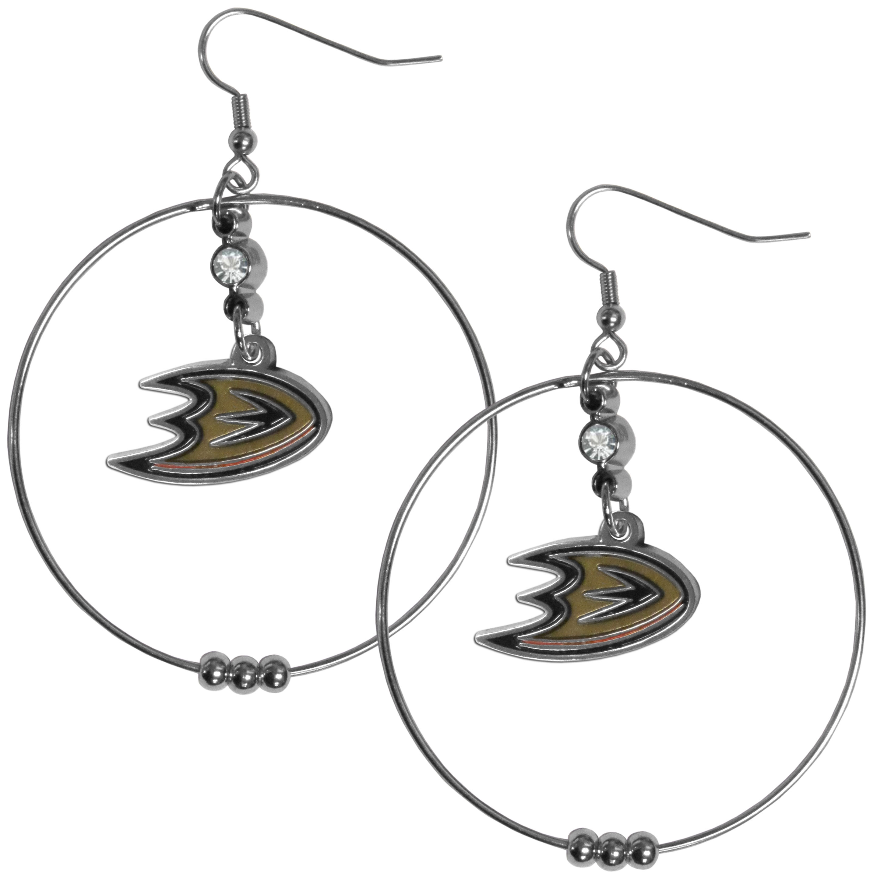 Anaheim Ducks® 2 Inch Hoop Earrings - Our large hoop earrings have a fully cast and enameled Anaheim Ducks® charm with enameled detail and a high polish nickel free chrome finish and rhinestone access. Hypoallergenic fishhook posts.