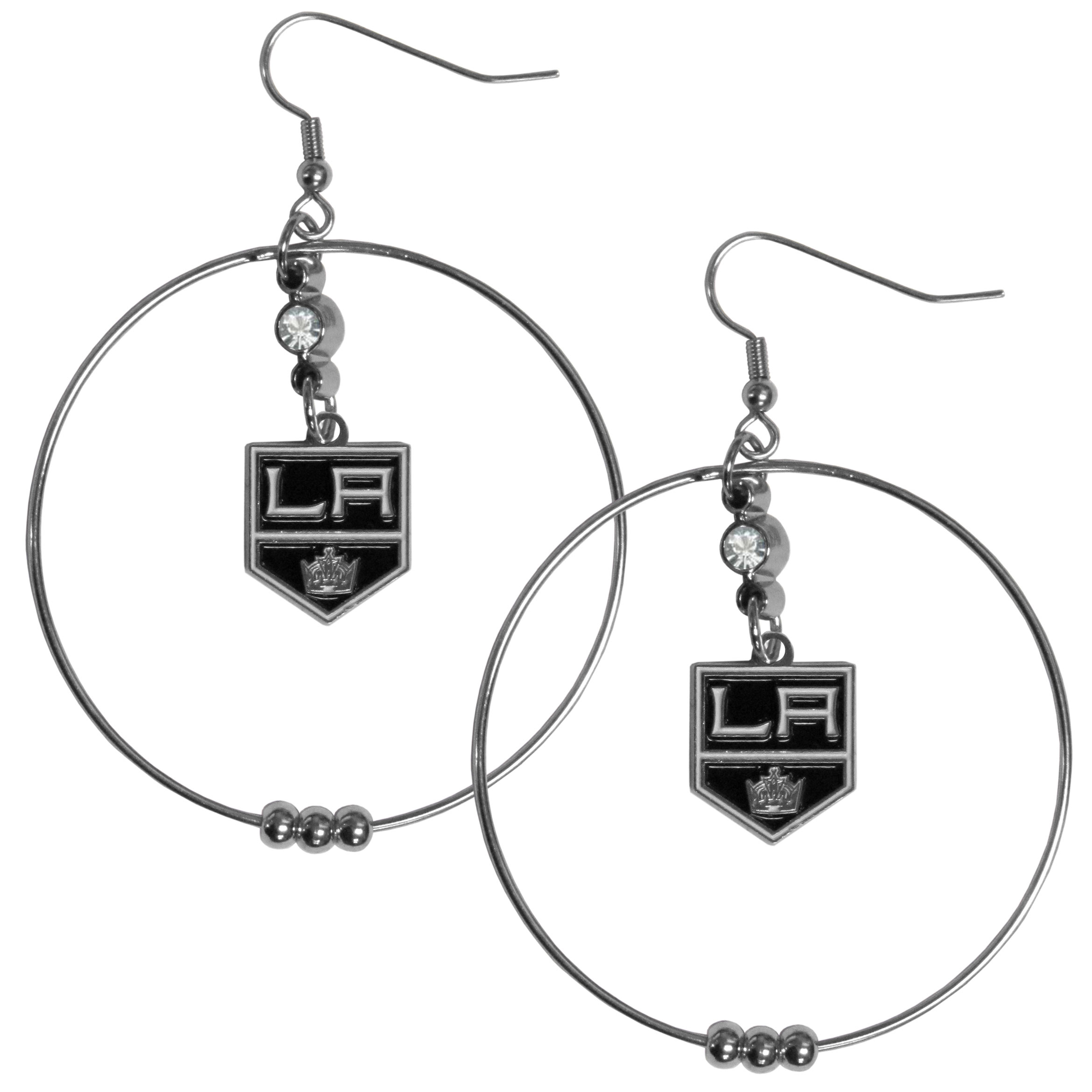 Los Angeles Kings® 2 Inch Hoop Earrings - Our large hoop earrings have a fully cast and enameled Los Angeles Kings® charm with enameled detail and a high polish nickel free chrome finish and rhinestone access. Hypoallergenic fishhook posts.