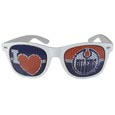 Edmonton Oilers  I Heart Game Day Shades - Our officially licensed I Heart game day shades are the perfect accessory for the devoted Edmonton Oilers  fan! The sunglasses have durable polycarbonate frames with flex hinges for comfort and damage resistance. The lenses feature brightly colored team clings that are perforated for visibility.