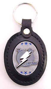 Large Leather Key Chain - Tampa Bay Lightning - This Tampa Bay Lightning key fob combines fine leather surrounding a sculpted & enameled team emblem. American craftsmanship makes this key ring a unique and long lasting gift. Made in America.