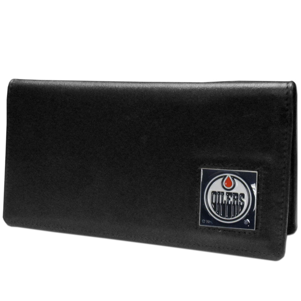 Edmonton Oilers® Leather Checkbook Cover - Our officially licensed checkbook covers is made of fine grain leather and features a fully cast and enameled Edmonton Oilers® emblem. The cover works for both top and side loaded checks and has a plastic sleeve for duplicate check writing.