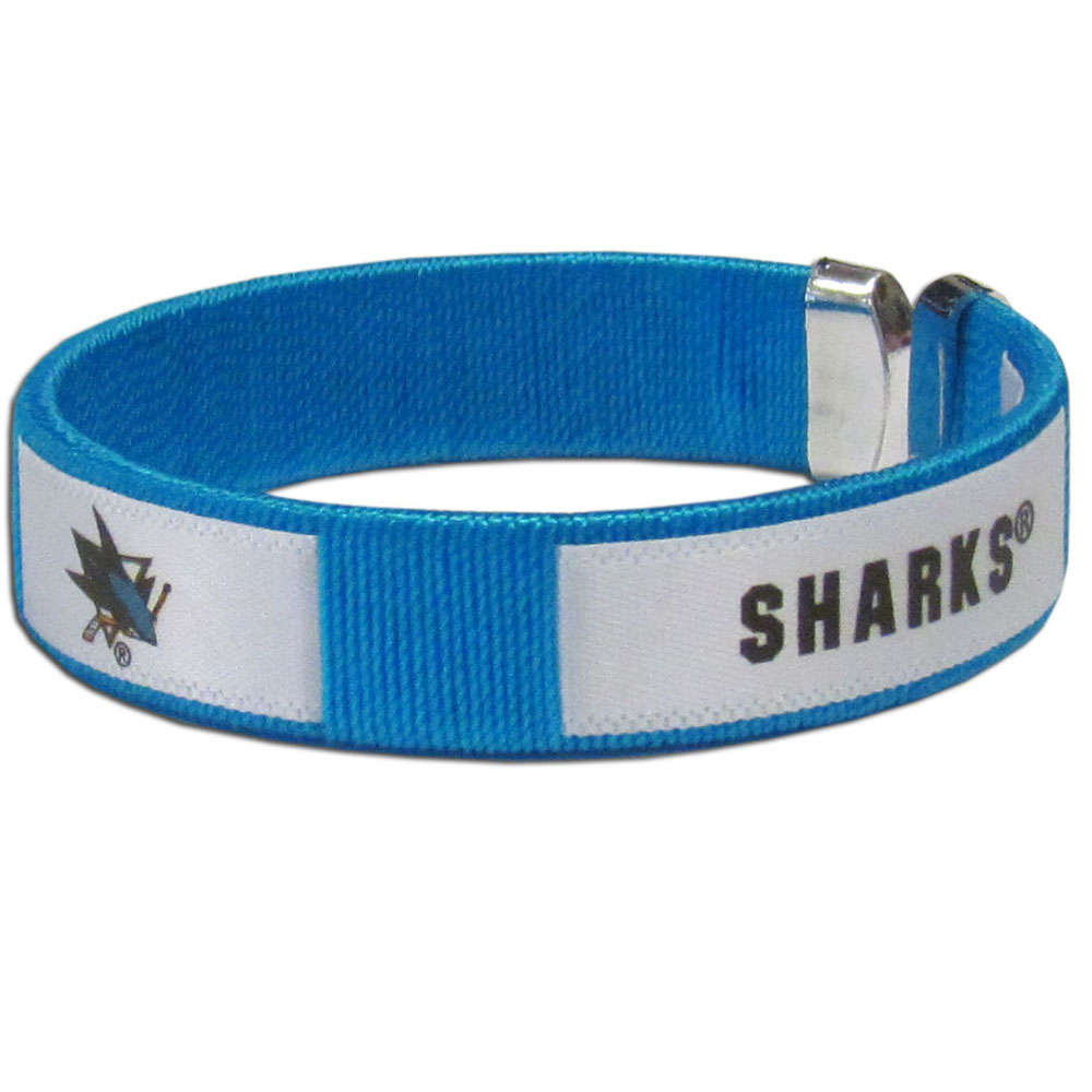 San Jose Sharks® Fan Bracelet - Our Fan Bracelet is a one size fits all string cuff bracelets with a screen printed ribbon with the team San Jose Sharks® name and logo.