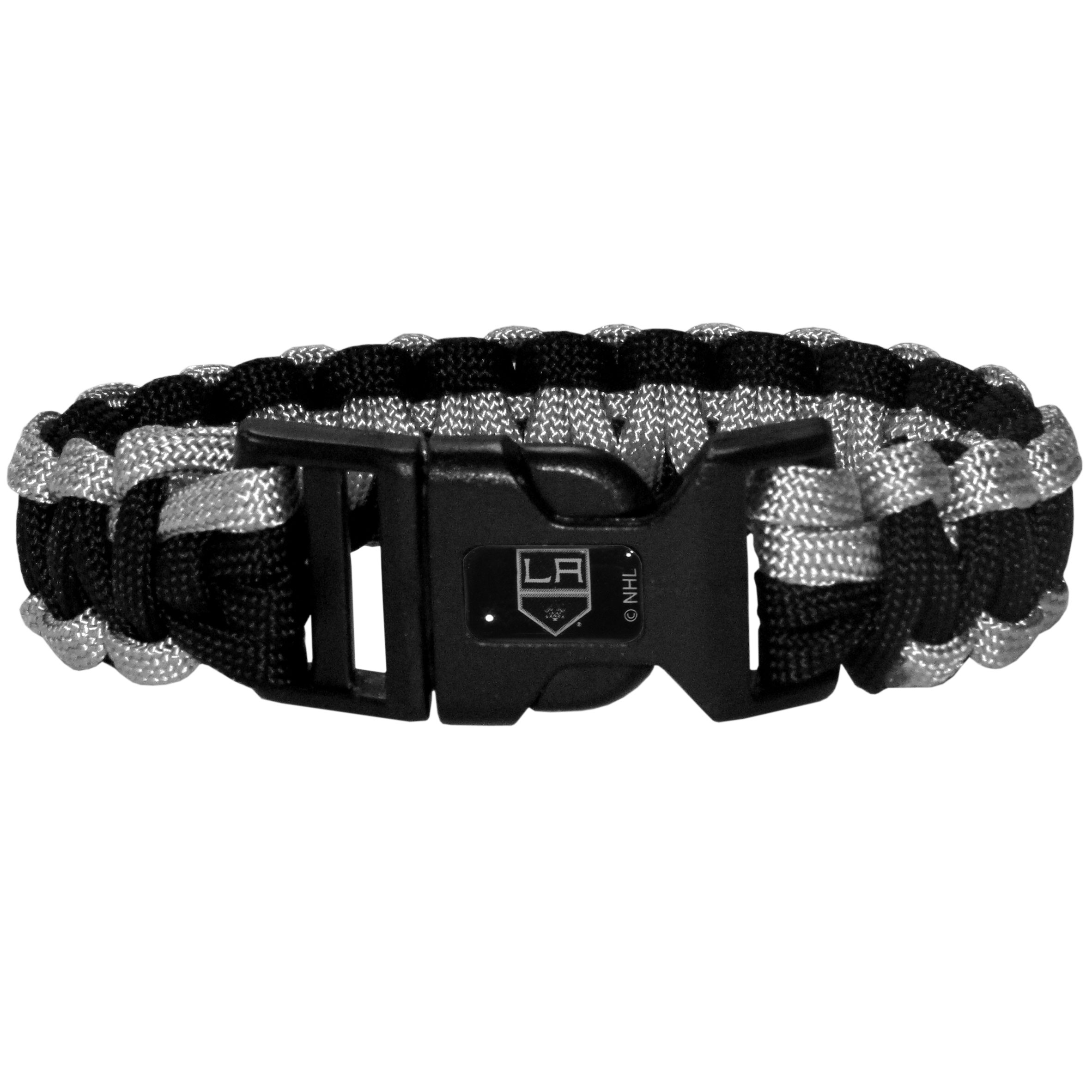Los Angeles Kings® Survivor Bracelet - Our functional and fashionable Los Angeles Kings® survivor bracelets contain 2 individual 300lb test paracord rated cords that are each 5 feet long. The team colored cords can be pulled apart to be used in any number of emergencies and look great while worn. The bracelet features a team emblem on the clasp.