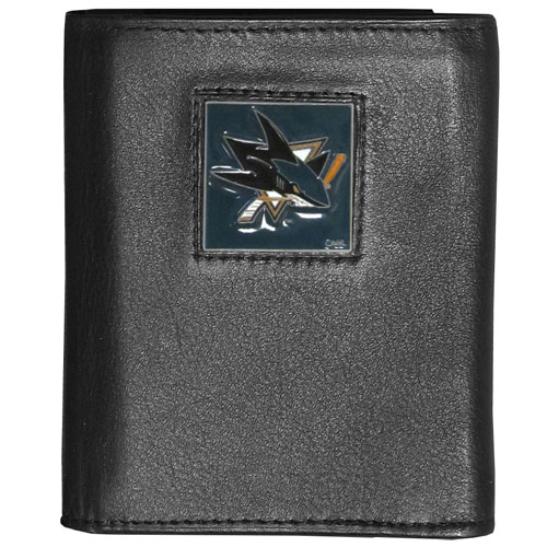 NHL Trifold Wallet in Box - San Jose Sharks - Our  NHL Tri-fold wallet is made of high quality fine grain leather with school logo sculpted and enameled with fine detail on the front panel.  Packaged in a window box that can be placed on a shelf or hung by a peg.
