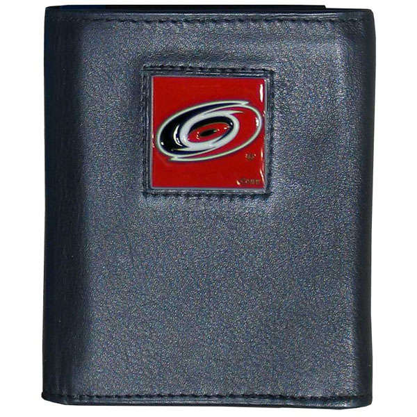 Carolina Hurricanes® Leather Tri-fold Wallet - Our Carolina Hurricanes® leather tri-fold wallet features a sculpted and hand painted team square on a black leather tri-fold. Includes an ID window, slots for credit cards and clear plastic photo sleeves. For a sporty feel, the liner of the wallet is made with a canvas liner.