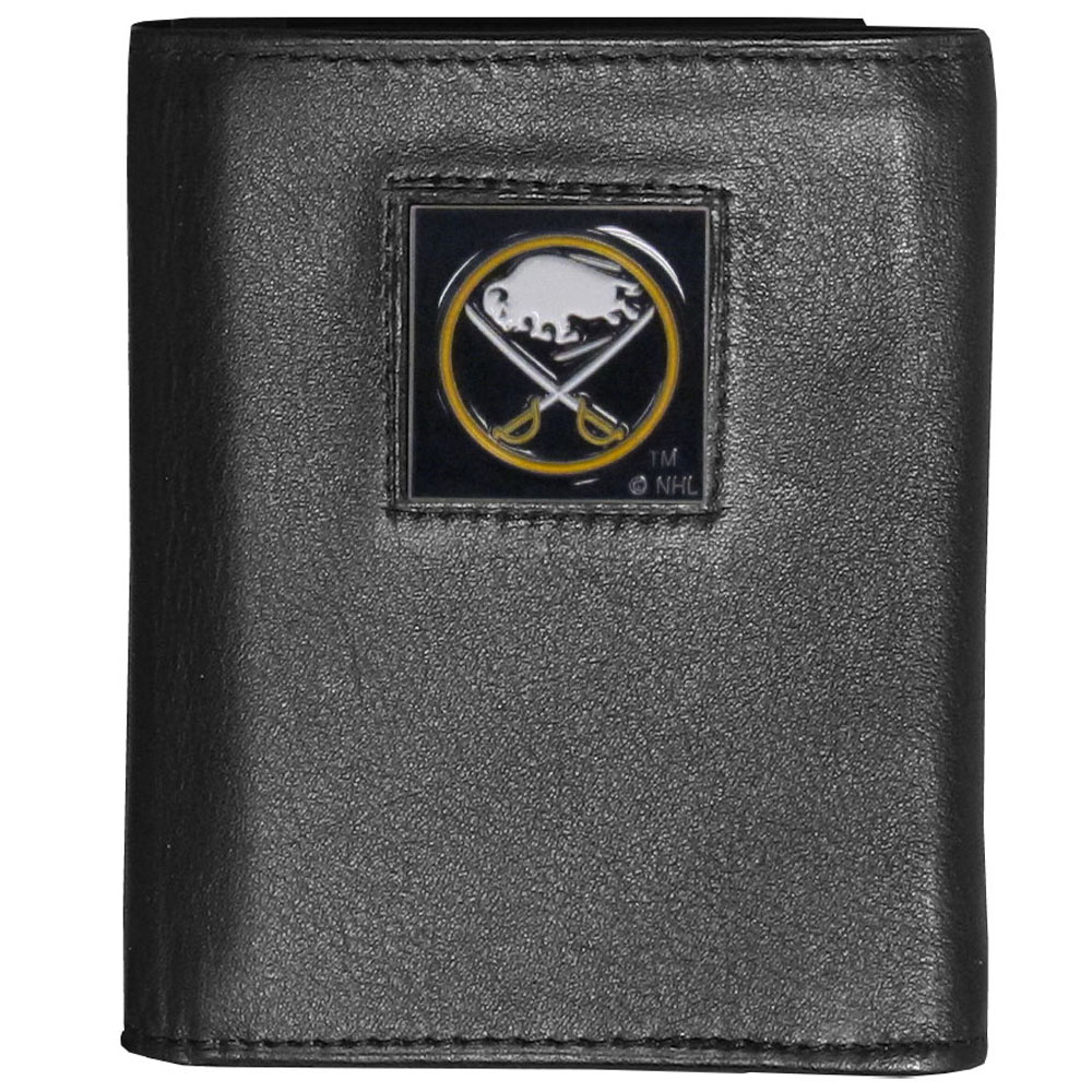 Buffalo Sabres® Leather Tri-fold Wallet - Our Buffalo Sabres® leather tri-fold wallet features a sculpted and hand painted team square on a black leather tri-fold. Includes an ID window, slots for credit cards and clear plastic photo sleeves. For a sporty feel, the liner of the wallet is made with a canvas liner.