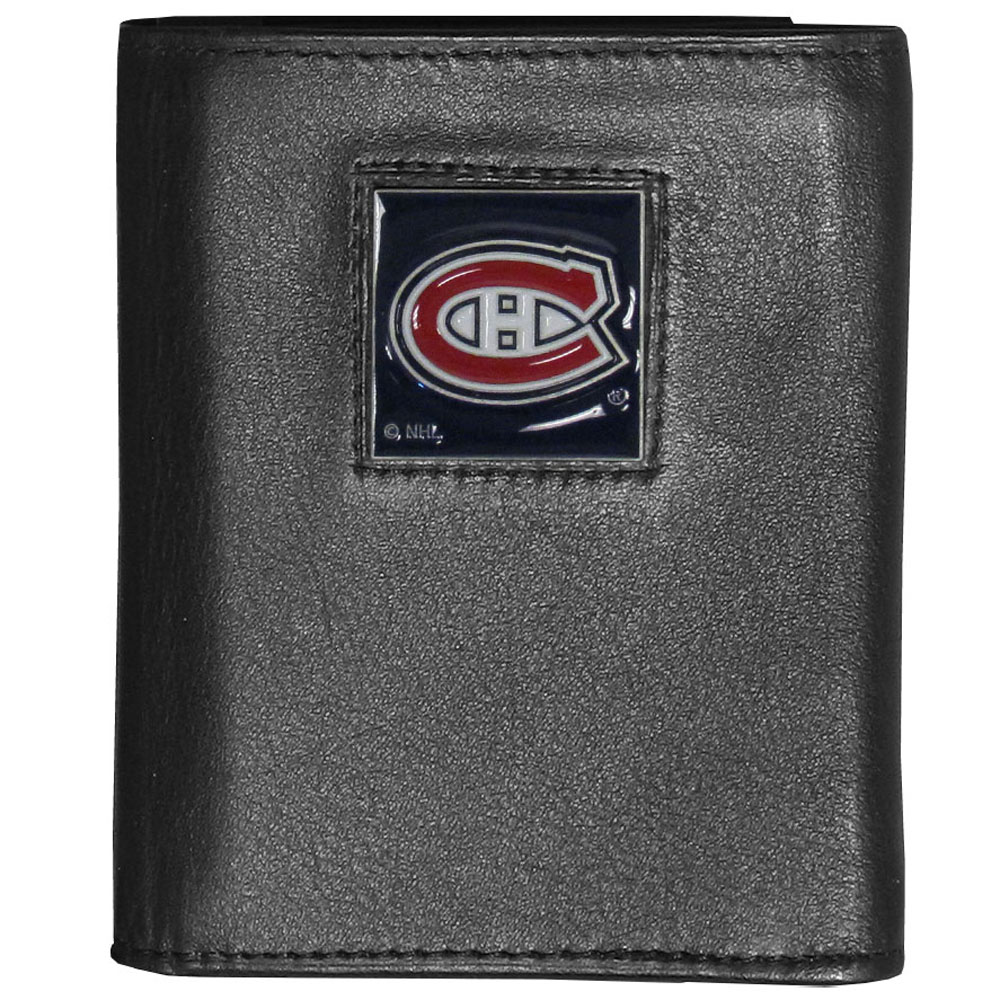 Montreal Canadiens® Deluxe Leather Tri-fold Wallet - Our officially licensed fine grain leather wallet features numerous card slots, windowed ID slots, removable picture slots and large billfold pockets. This quality wallet has an enameled Montreal Canadiens® emblem on the front of the wallet making it a stylish way to show off your team pride.