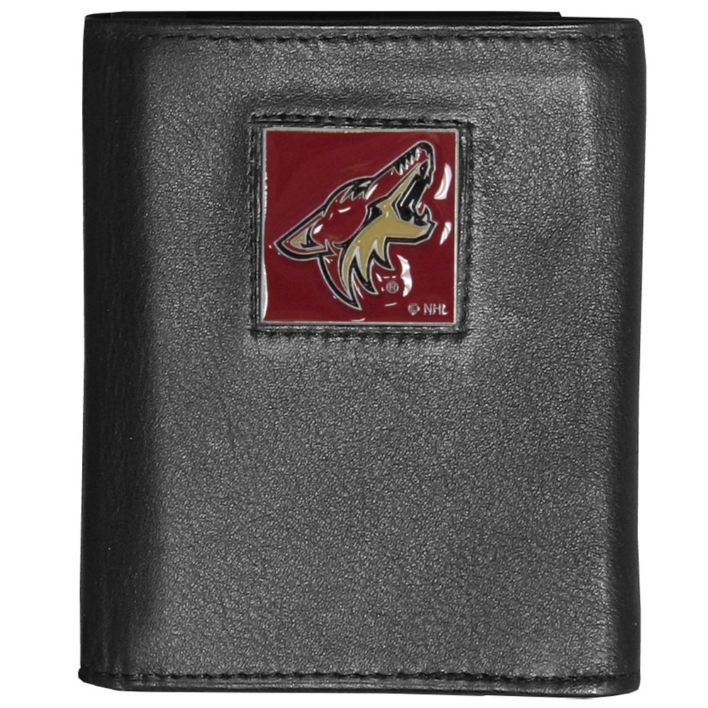Arizona Coyotes® Deluxe Leather Tri-fold Wallet - Our officially licensed fine grain leather wallet features numerous card slots, windowed ID slots, removable picture slots and large billfold pockets. This quality wallet has an enameled Arizona Coyotes® emblem on the front of the wallet making it a stylish way to show off your team pride.
