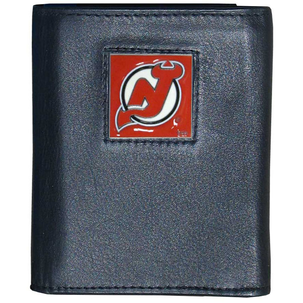 New Jersey Devils® Leather Tri-fold Wallet - Our New Jersey Devils® leather tri-fold wallet features a sculpted and hand painted team square on a black leather tri-fold. Includes an ID window, slots for credit cards and clear plastic photo sleeves. For a sporty feel, the liner of the wallet is made with a canvas liner.