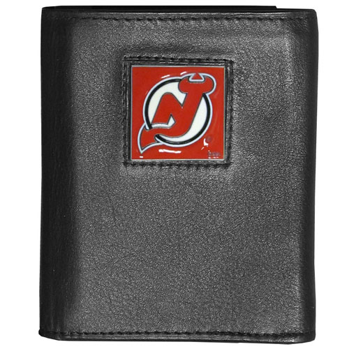 NHL Trifold Wallet in Box - New Jersey Devils - NHL Tri-fold New Jersey Devils wallet is made of high quality fine grain leather with school logo sculpted and enameled with fine detail on the front panel. Packaged in a window box.