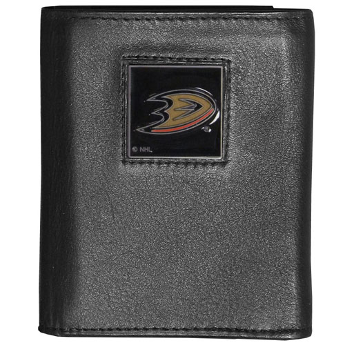 Anaheim Ducks Leather Tri-fold Wallet - Officially licensed NHL Anaheim Ducks fine grain leather wallet features numerous card slots, windowed ID slots, removable picture slots and large billfold pockets. This quality Anaheim Ducks wallet has an enameled Anaheim Ducks emblem on the front of the wallet. Thank you for visiting CrazedOutSports