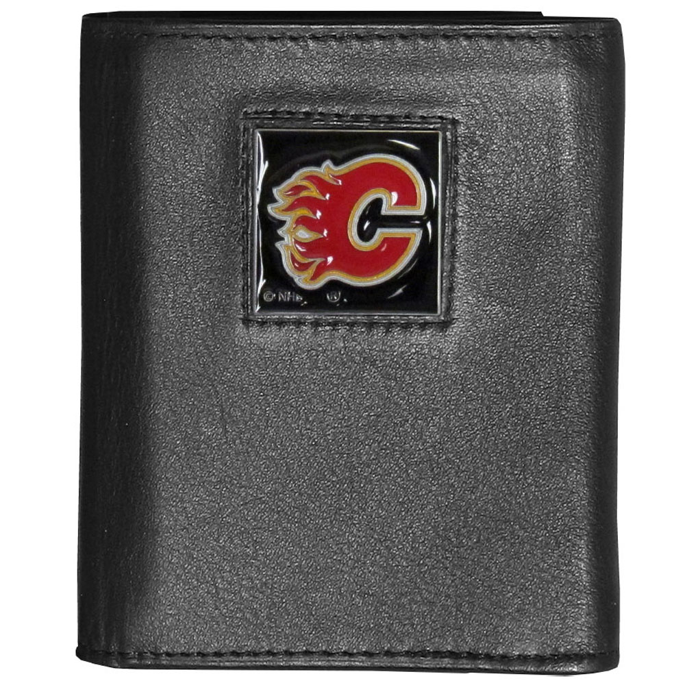 Calgary Flames® Deluxe Leather Tri-fold Wallet - Our officially licensed fine grain leather wallet features numerous card slots, windowed ID slots, removable picture slots and large billfold pockets. This quality wallet has an enameled Calgary Flames® emblem on the front of the wallet making it a stylish way to show off your team pride.