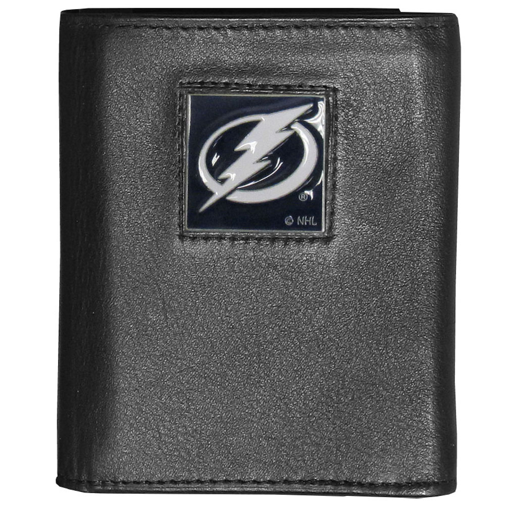 Tampa Bay Lightning® Deluxe Leather Tri-fold Wallet - Our officially licensed fine grain leather wallet features numerous card slots, windowed ID slots, removable picture slots and large billfold pockets. This quality wallet has an enameled Tampa Bay Lightning® emblem on the front of the wallet making it a stylish way to show off your team pride.