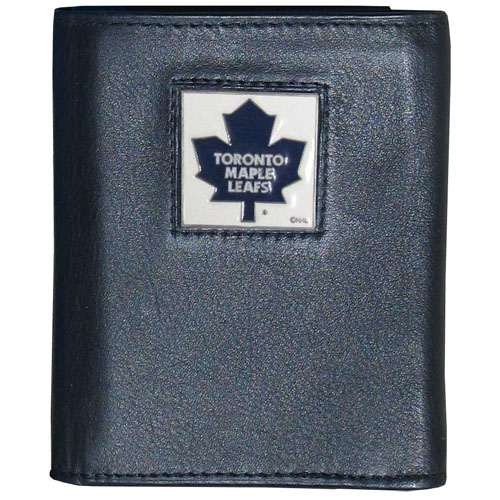 Toronto Maple Leafs® Leather Tri-fold Wallet - Our Toronto Maple Leafs® leather tri-fold wallet features a sculpted and hand painted team square on a black leather tri-fold. Includes an ID window, slots for credit cards and clear plastic photo sleeves. For a sporty feel, the liner of the wallet is made with a canvas liner.