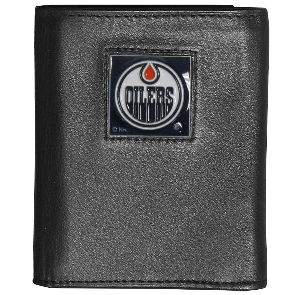 Edmonton Oilers® Deluxe Leather Tri-fold Wallet - Our officially licensed fine grain leather wallet features numerous card slots, windowed ID slots, removable picture slots and large billfold pockets. This quality wallet has an enameled Edmonton Oilers® emblem on the front of the wallet making it a stylish way to show off your team pride.