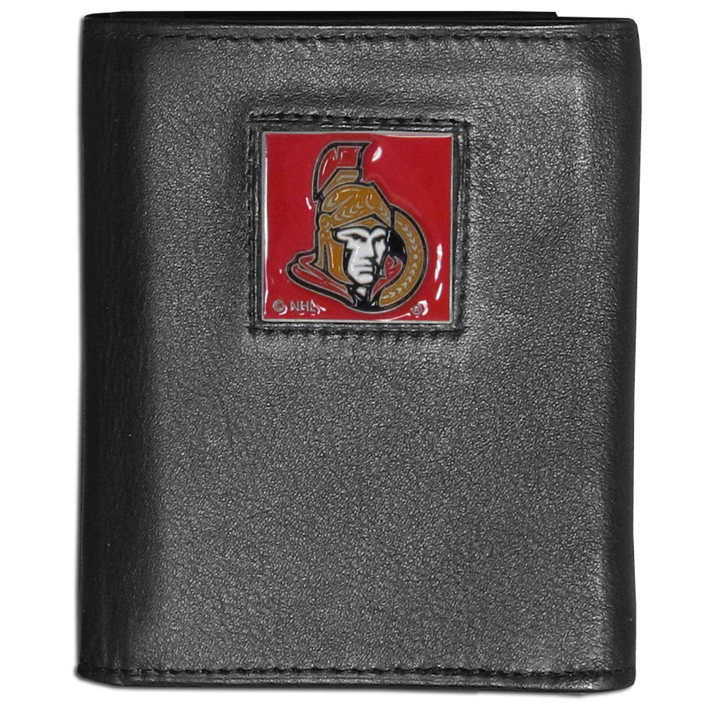 Ottawa Senators® Leather Tri-fold Wallet - Our Ottawa Senators® leather tri-fold wallet features a sculpted and hand painted team square on a black leather tri-fold. Includes an ID window, slots for credit cards and clear plastic photo sleeves. For a sporty feel, the liner of the wallet is made with a canvas liner.