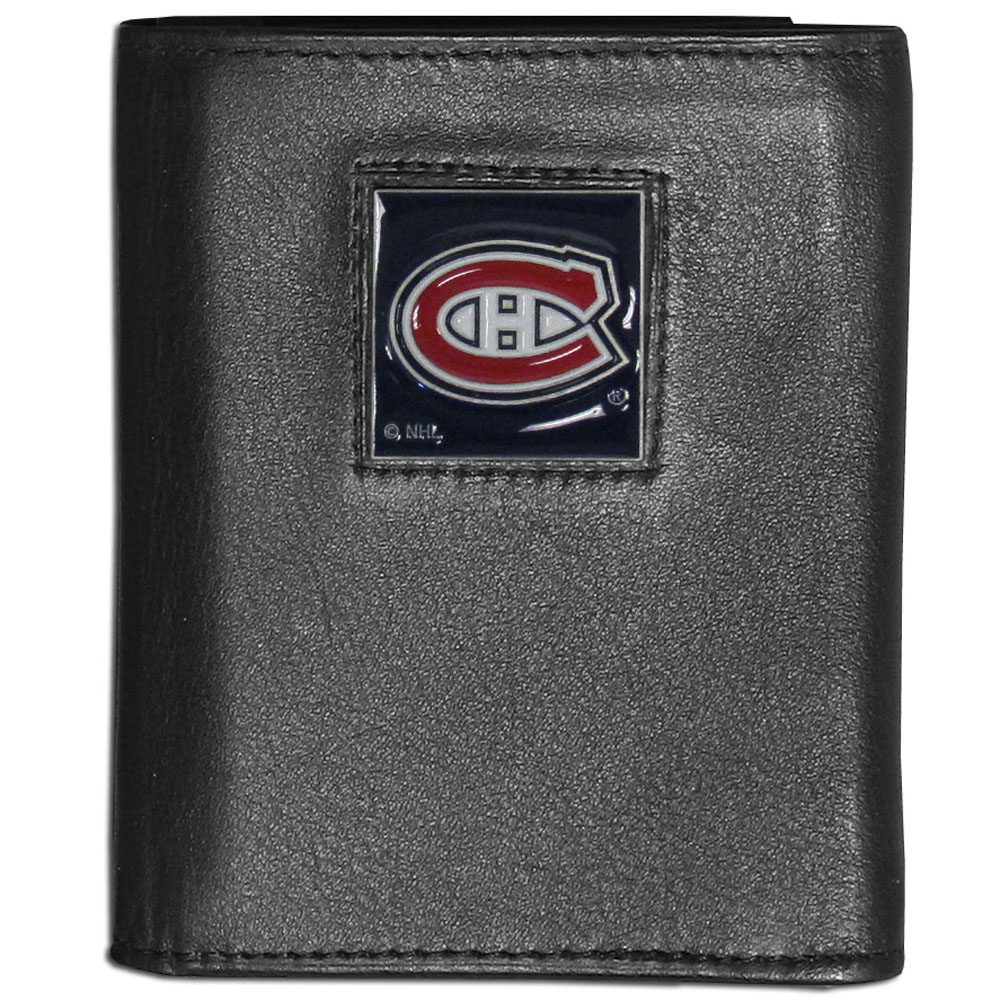 Montreal Canadiens® Leather Tri-fold Wallet - Our Montreal Canadiens® leather tri-fold wallet features a sculpted and hand painted team square on a black leather tri-fold. Includes an ID window, slots for credit cards and clear plastic photo sleeves. For a sporty feel, the liner of the wallet is made with a canvas liner.