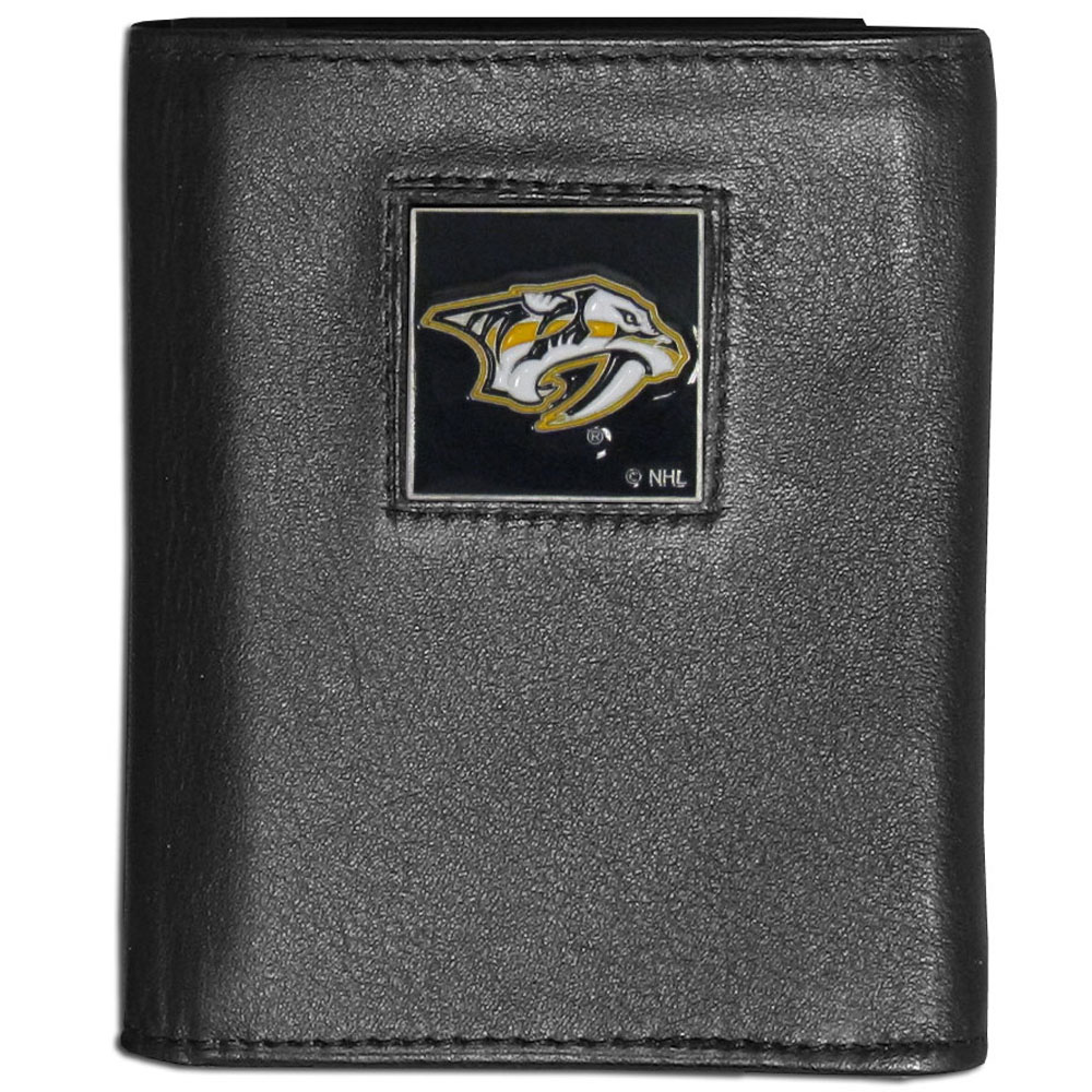 Nashville Predators® Leather Tri-fold Wallet - Our Nashville Predators® leather tri-fold wallet features a sculpted and hand painted team square on a black leather tri-fold. Includes an ID window, slots for credit cards and clear plastic photo sleeves. For a sporty feel, the liner of the wallet is made with a canvas liner.