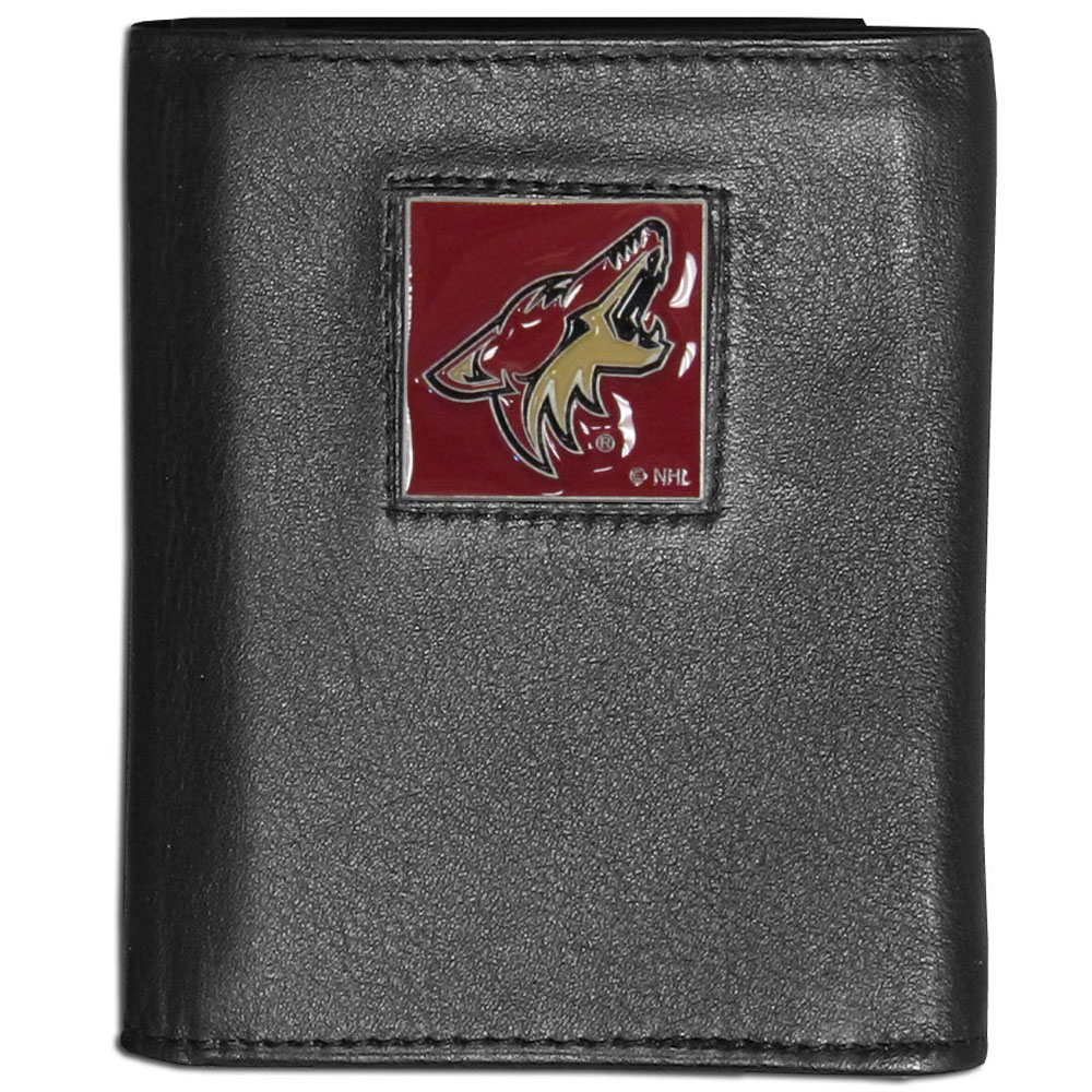 Arizona Coyotes® Leather Tri-fold Wallet - Our Arizona Coyotes® leather tri-fold wallet features a sculpted and hand painted team square on a black leather tri-fold. Includes an ID window, slots for credit cards and clear plastic photo sleeves. For a sporty feel, the liner of the wallet is made with a canvas liner.