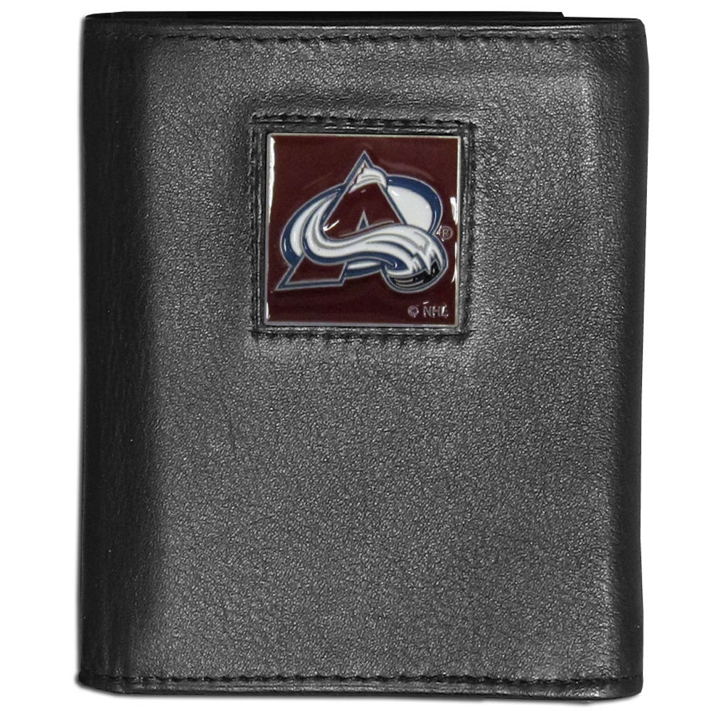 Colorado Avalanche® Leather Tri-fold Wallet - Our Colorado Avalanche® leather tri-fold wallet features a sculpted and hand painted team square on a black leather tri-fold. Includes an ID window, slots for credit cards and clear plastic photo sleeves. For a sporty feel, the liner of the wallet is made with a canvas liner.
