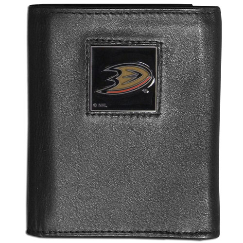 Anaheim Ducks Leather Tri-fold Wallet - NHL Anaheim Ducks collectors leather/nylon tri-fold wallet features a sculpted and hand painted Ducks square on a black leather trifold. Includes an ID window, slots for credit cards and clear plastic photo sleeves. For a sporty feel, the liner of the Anaheim Ducks wallet is made with a canvas liner. Thank you for visiting CrazedOutSports