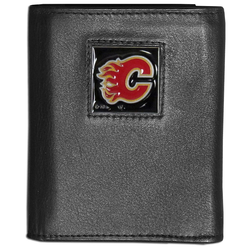 Calgary Flames® Leather Tri-fold Wallet - Our Calgary Flames® leather tri-fold wallet features a sculpted and hand painted team square on a black leather tri-fold. Includes an ID window, slots for credit cards and clear plastic photo sleeves. For a sporty feel, the liner of the wallet is made with a canvas liner.