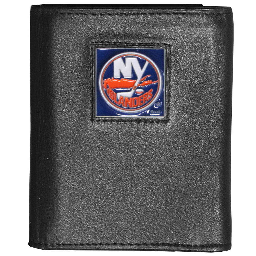 New York Islanders® Leather Tri-fold Wallet - Our New York Islanders® leather tri-fold wallet features a sculpted and hand painted team square on a black leather tri-fold. Includes an ID window, slots for credit cards and clear plastic photo sleeves. For a sporty feel, the liner of the wallet is made with a canvas liner.