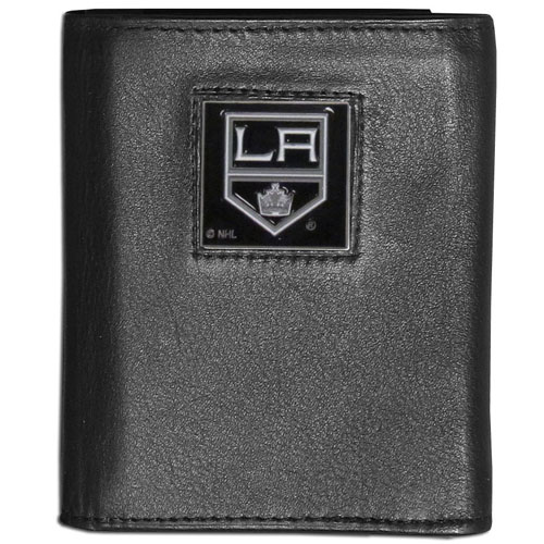 Los Angeles Kings Leather Tri-fold Wallet - NHL Los Angeles Kings leather/nylon tri-fold wallet features a sculpted and hand painted Kings square on a black leather trifold. Includes an ID window, slots for credit cards and clear plastic photo sleeves. For a sporty feel, the liner of the Los Angeles Kings wallet is made with a canvas liner.