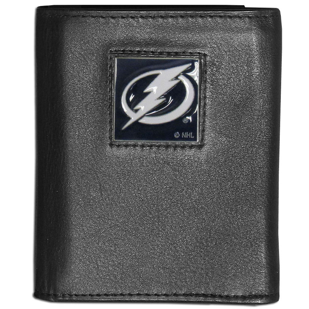 Tampa Bay Lightning® Leather Tri-fold Wallet - Our Tampa Bay Lightning® leather tri-fold wallet features a sculpted and hand painted team square on a black leather tri-fold. Includes an ID window, slots for credit cards and clear plastic photo sleeves. For a sporty feel, the liner of the wallet is made with a canvas liner.